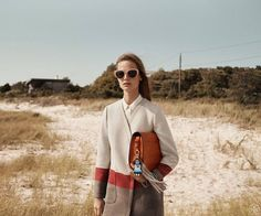 Model wears Stripe Blanket Coat, Toggle-Hinge Cat Eye Sunglasses for lookbook photoshoot