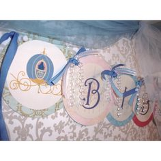 Cinderella banner. Grab lots of pearl garlands at Christmas!  They make great additions to banners.