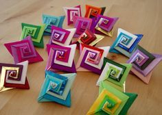 Easy to make origami spirals.   Tutorial at: http://anu-origami.blogspot.de/2011/02/origami-tomoko-fuse-espiral.html