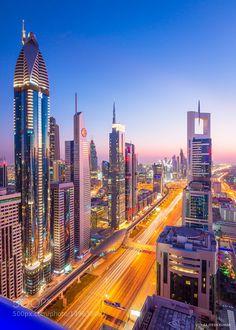 The skyscrapers along Sheikh Zayed Road in Dubai, at sunset. City Wallpaper, Black Wallpaper, Dubai Tourist Spots, City Lights At Night, Carthage, City Architecture, Fantasy Landscape, City Photography, Street Photo
