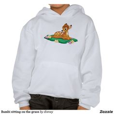 Bambi sitting on the grass hooded sweatshirt