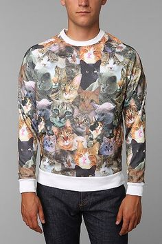 First, I saw this on Chive (see Cat Saturday sweater in this board), but I just thought it was an ebay funny ugly sweater thing. Apparently, I'm wrong...and its for men who like cats! Color me tickled...Cats On Cats Pullover Sweatshirt