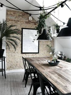For the environment lovers, this greenhouse inspired dining room is perfect. Exposed brick walls for rustic touch, skylights for natural lighting, bare wood floors and scrubbed tables.