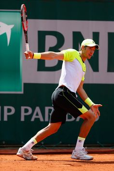 Dusan Lajovic Photos - Dusan Lajovic of Serbiain action in his Men's Singles match against Stanislas Wawrinka of Switzerland during day four of the 2015 French Open at Roland Garros on May 2015 in Paris, France. - Dusan Lajovic Photos - 251 of 291 Rod Laver Arena, Wimbledon Champions, French Open, Paris France, Switzerland, Melbourne, Action, Running, Day