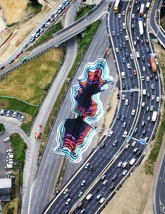 within paris' 13th arrondissement, german artist 1010 has transformed a busy highway into an optical illusion.