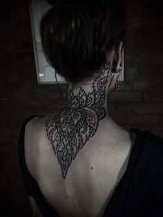 love the detail and usually neck tattoos on women can border on masculine. this one is very lady like