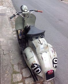 "vespaoriginali: ""Vespa VL1 with rare extra gas tank accessory. Note the blanking plate in place of a speedometer. """