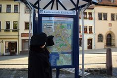 Luther found a map of Lutherstadt Eisleben in the town center. Can you guess which location he's searching for? What do you think he wants to see first?