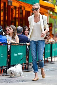 For a slightly more casual look that's still ready to go into meetings, copy Olivia Palermo's outfit. Her Paige jeans could work any day of the week, but she kept them office-appropriate with a silky blouse, matching blazer, and nude ballet flats.