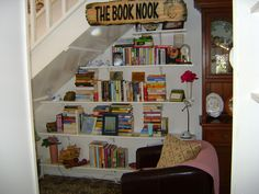 'My 'Book Nook' book shelves are my pièce de résistance. This is the area under my internal stairs which is normally difficult to utilise so I decided one day that it would be an ideal place for book shelves and a small chair and could become my book nook. I love it.'  -Melanie from Good Reading