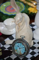 Alice in Wonderland teacups and rabbits decor can be found at thrift shops.