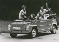 Remember when you could speed down the road without seat belts, playing a guitar, sitting on the hood of a car, with your back to the road? Us neither. #BeSafe #TBT #VW #Thing #Seatbelts