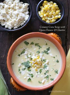Creamy Corn Soup With Queso Fresco And Cilantro With Olive Oil, Scallions, Garlic Cloves, Corn Kernels, Russet Potatoes, 1% Low-fat Milk, Chicken Stock Cubes, Chopped Fresh Cilantro, Reduced-fat Sour Cream, Salt, Pepper, Queso Fresco