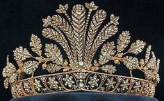 The cut steel tiara belonged to Queen Hortense of Holland who at one point gave them as a gift to her niece Jos phine of Leuchtenberg, later Queen Josefina of Sweden.