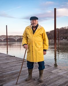 Foto de stock : Older Caucasian fisherman standing on dock Street Photography, Fashion Photography, Art Photography, Ceramic Sculpture Figurative, Fishing Pictures, Yellow Raincoat, Raincoats For Women, Rain Wear, Drawing People
