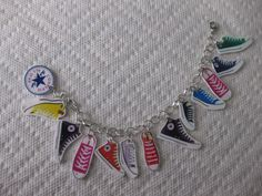Make a charm bracelet in under 120 minutes by jewelrymaking and melting with shrinky dink, shrinky dink, and punch. Inspired by converse. Creation posted by Mickie. Shrink Paper, Shrink Art, Shrinky Dinks, Plastic Fou, Cool Converse, Shrink Plastic Jewelry, Shrink Film, Do It Yourself Jewelry, Bijoux Diy