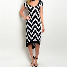 Stunning hi lo chevron midi w/back cut out! Pretty scoop neck and capped sleeves- rounded hi lo hem with black trim- flattering back cut out- a hint of stretch for a flattering fit! Dresses Midi