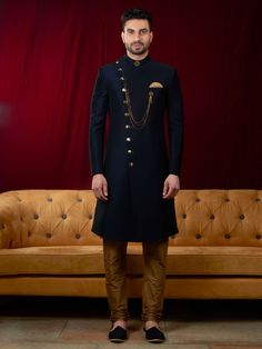 Navy blue silk fabricated plain wedding sherwani from our latest collection, it features with cross open pattern mandarin collar, one pocket on chest with pocket square and broach add more glame in this outfit. It comes with golden color chudidhar bottom. Sherwani For Men Wedding, Wedding Dresses Men Indian, Sherwani Groom, Mens Sherwani, Formal Dresses For Men, Wedding Dress Men, Wedding Men, Nigerian Men Fashion, Indian Men Fashion