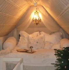 A tiny attic bedroom, could be a tiny house bedroom too.