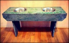 DIY food bowl stand for large dogs. Turn an old bench into a bowl stand for dogs and it keeps the bowls off your floor, prevents larger dogs from having to bend over to eat, and looks much better than the store bought stands.