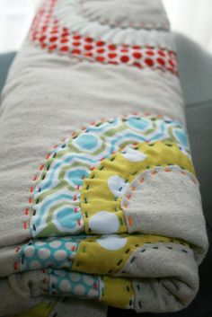 maybe i should hand quilt like this next time, i love the effect of colored thread through the piecing!