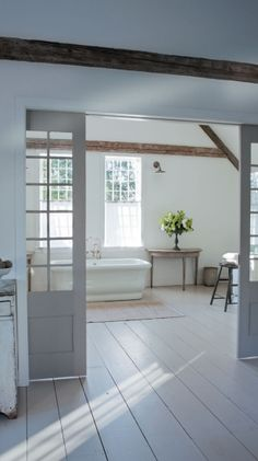 Love the white wide plank floor boards.....