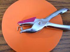 Improve scissor skills - using a hole punch