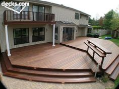 Low Elevation Deck Picture Gallery | Like the color of deck and the patio below! | Also like the bayed jet-out area with sliding glass door. We could do that when we build the master bedroom!