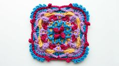 Colorful overlay crochet square tutorial, part 1 of 3. Step by step crochet instructions to create the colorful overlay crochet square. You can use the square for afghan, scarf, cushion cover, baby blanket, poncho etc. or a trim on other items. Crochet tutorial. Crochet instructions. Learn to crochet. Crochet techniques. Granny square.