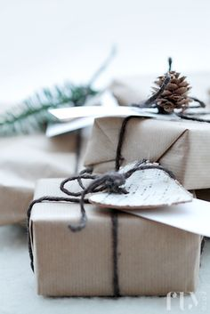 Wrap your gifts with craft paper and twine, then decorate with an element from nature: a piece of birch bark, pine cone, or sprig of pine.