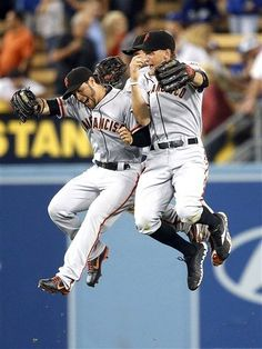 San Francisco Giants' Gregor, Angel, & Hunter celebrate their team's 2-1 win against the Los Angeles Dodgers