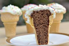 ICE CREAM CONE CUPCAKES    Measure out about 1.5 tbsp batter into each cone, fill cone about 2/3 full.  Bake for 25 mins.   Once cupcakes have cooled, frost each cone. You want the frosting to look like ice cream. Decorate with sprinkles and enjoy!