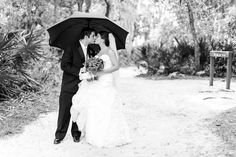 a little rain on your wedding day is good luck...and an umbrella makes for a cute wedding photo!