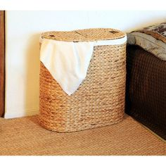 Sort laundry in style with this must-have double hamper, artfully hand-woven from water hyacinth.