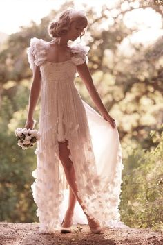 Okay, I could actually see wearing something like this, with slightly less poufy sleeves.  Like fairy meets princess.