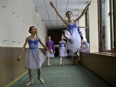 Moscow, Russia: Students perform in a corridor