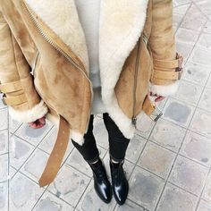 shearling jacket and black jeans.