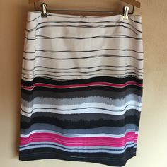 Striped Cato skirt This is a beautiful white gray pink and black striped skirt. Size 12, Cato brand. Fully lined. In great condition. Cato Skirts Midi