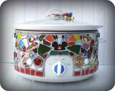 How have I gone through life without a Disney mosaic crockpot?  Think I might try this...but a bit more matchy-matchy:)