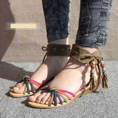 Bohemian flat sandals with cute tassels add to everything fun.