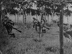 Japanese soldiers Banzai attack with Arisaka Type 99 rifles