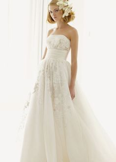 With a sweetheart neckline and lace sleeves...