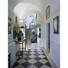 The hallway with original stone floor and vaulted ceiling at 9, The Circus. The Georgian townhouse was designed by John Wood in 1754 in Bath, England