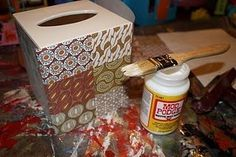 the trick is to get a cheap kleenex box cover, and mod podge paper on it.another good idea ! Tissue Box Crafts, Paper Crafts, Diy Crafts, Tissue Box Covers, Tissue Boxes, Dress Up Storage, Storage Center, Kleenex Box, Do It Yourself Crafts