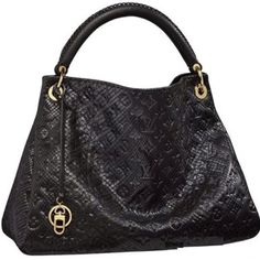 OMG. This would be a perfect purse for fall/winter. Louis Vuitton Python.