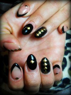 Almond shaped nails, black and gold studs