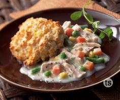 Slow Cooker Chicken a la King Recipe │Savory chicken slow-cooked and blended with vegetables and cream to create a rich and creamy meal served with biscuits.