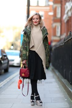 Meet the new urban uniform: camo jacket, sliver platforms, and mini crossbody. Brava! #refinery29 http://www.refinery29.com/london-fashion-week-street-style#slide-62