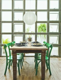 green chairs + windows wall