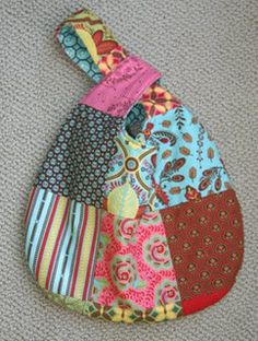 Grab Bag pattern by BH & G. Here is a tutorial to make a child-sized version: http://smallfryandco.blogspot.com/2009/02/cute-little-girl-purse-tutorial.html  And here is the original pattern the blogger used: www.allpeoplequilt.com/bags-pillows-gifts/bags-and-purses/grab-bags